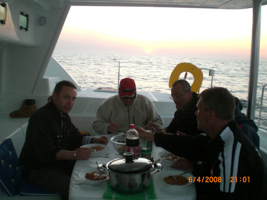 View west, The crew at dinner
