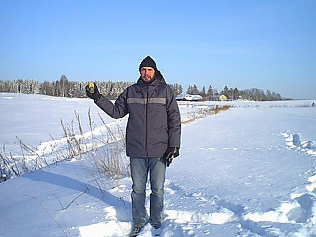 "Olli ""Almost"" Suutela standing at the confluence point."