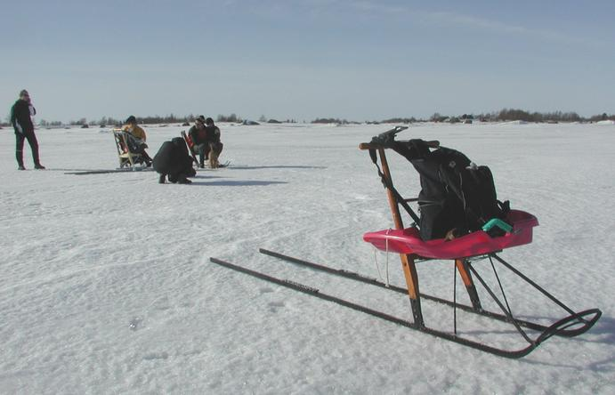 Kick sled with GPS device at confluence.