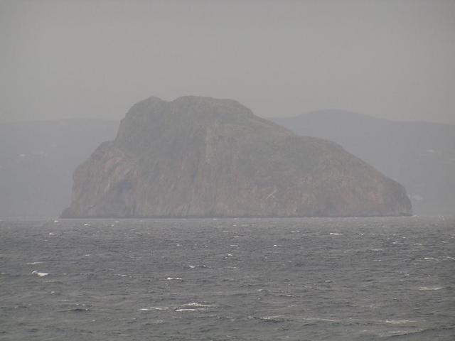 Closer view of Avgó Islet, the closest land to the Confluence