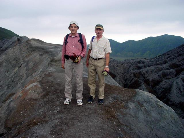 Laurent (left) and Guy (right) ready to throw flowers into the Bromo crater