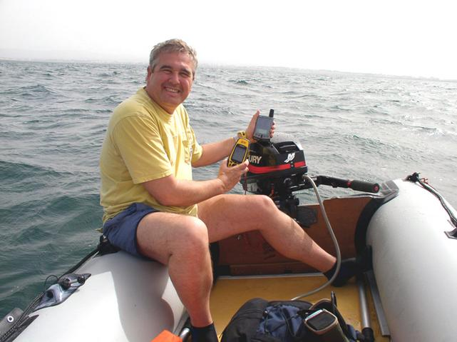 Me with the GPS and the Palm on the boat