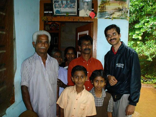 Lakshman with the Varghese family