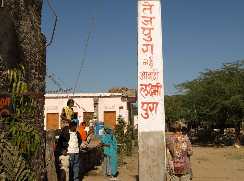 Local Residents.  The Village Name, Tejpura, Is Written On The Utility Pole.