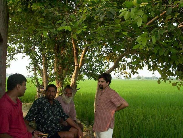With villagers at farm