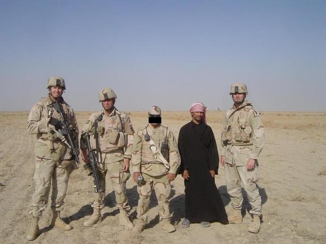 Standing in front of the confluence point (from left to right, LT Paul P., TSgt Jeff G., Karim, Mohanen, & LT Scott T.)