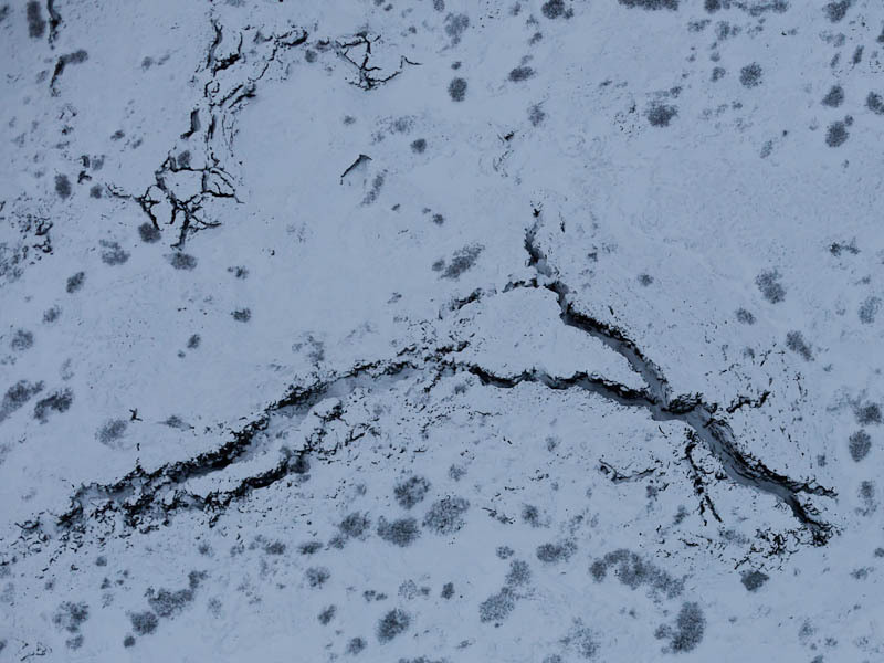 Aerial photo of snow covered lava fissures (7 Dec 2011)
