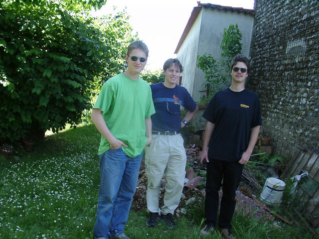 Basti, Christoph and Michael at the confluence point (corner of the house)