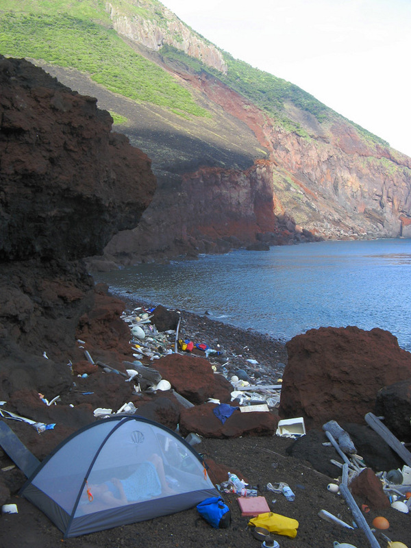 A rough camp on the uninhabited Yokoate-jima on the morning of the confluence visit.  In East Asia, where environmental thinking is still in its infancy, this amount of flotsam is normal even on the remotest coasts.