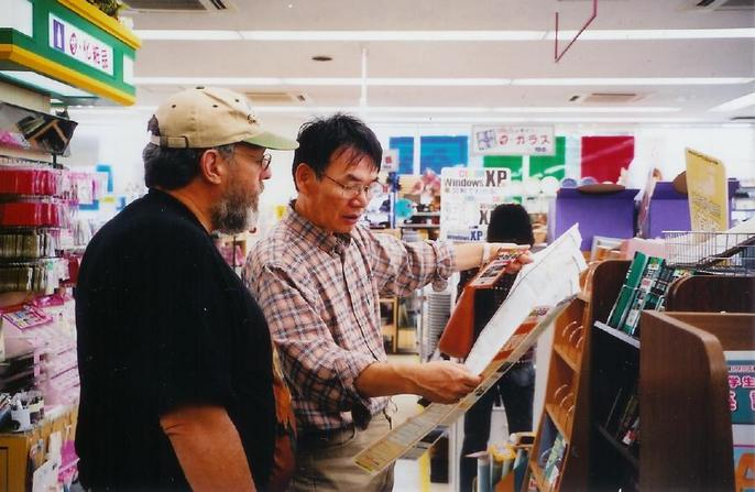 Abe san helping to get a good map at book store.