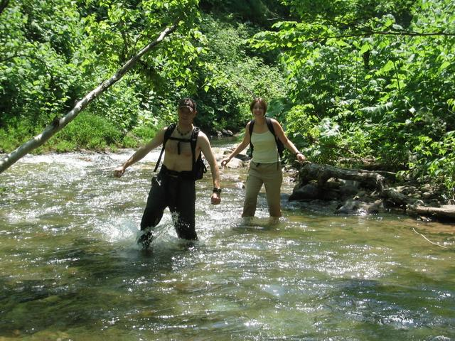 Mitch and Krista walking in the stream.