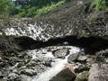#4: Snow in summer?!  Stream carves a cave through one of winter's avalanches.