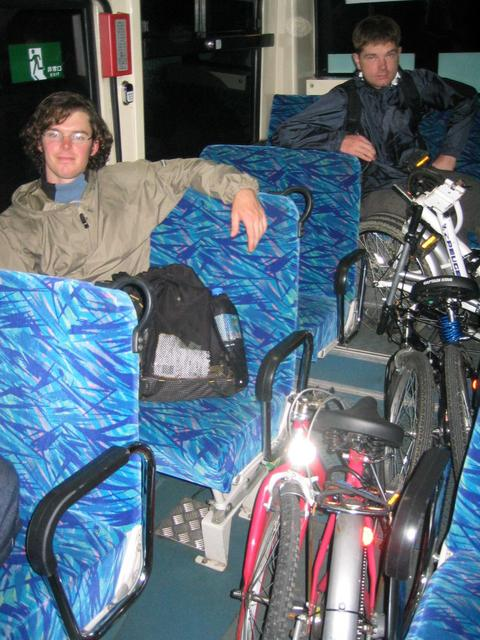 Bikes folded up on bus on a tired trip home.