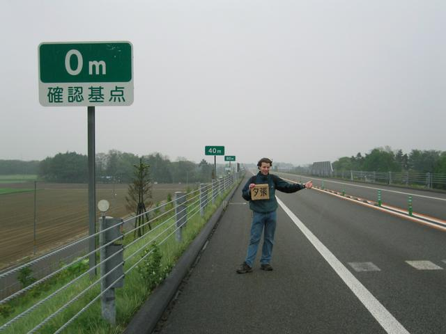 Hitchhiking on the expressway in the rain.