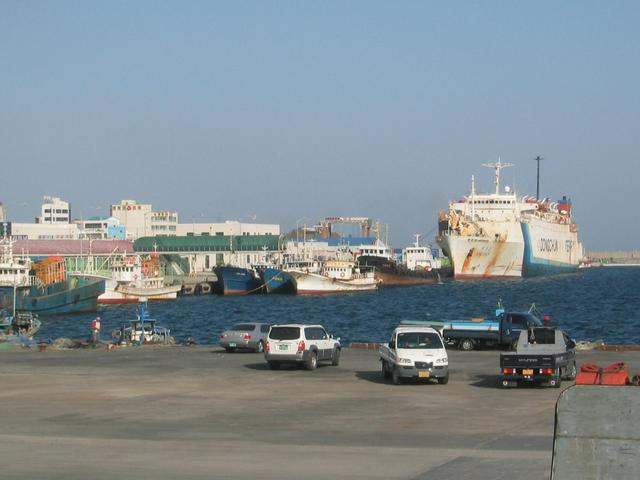 Sokcho harbor with big Russian ferry to right rear, Chinese cargo boats in front of it.