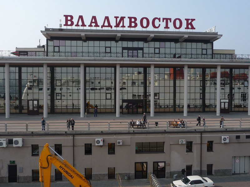 The Vladivostok marine terminal shows the reflection of the Dong Chun boat as it leaves.