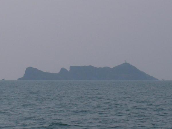 Closeup of Namuseom: a lighthouse is faintly visible on top of the isle