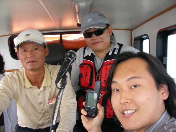 Visitors (left to right): ship's captain (Hae-Yun Choi), a fisherman, and me (Wesley)