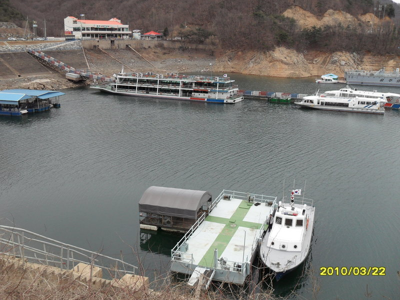 Police patrol boat in the foreground, tourist ferry docked in the far side