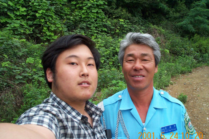 A photo with the kind taxi driver who helped me in finding the confluence.
