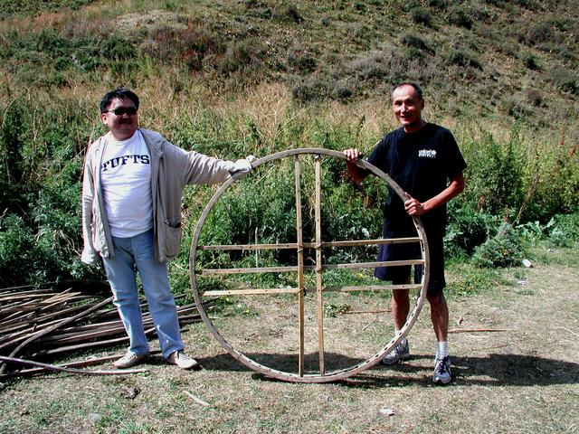 Ayadil and Ray holding the top structure of a yurt near the CP