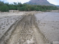 #9: Muddy road that suggests an approach by 4WD