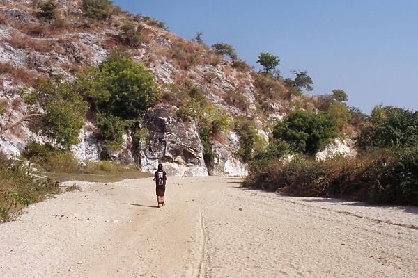 Ma Htar Htar Thu walking back on the dry riverbed
