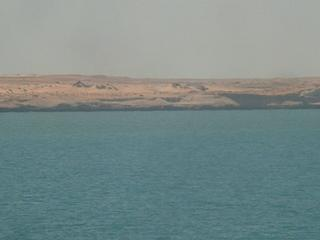 #1: Peninsula of Cap Blanc's coastline seen from the Confluence