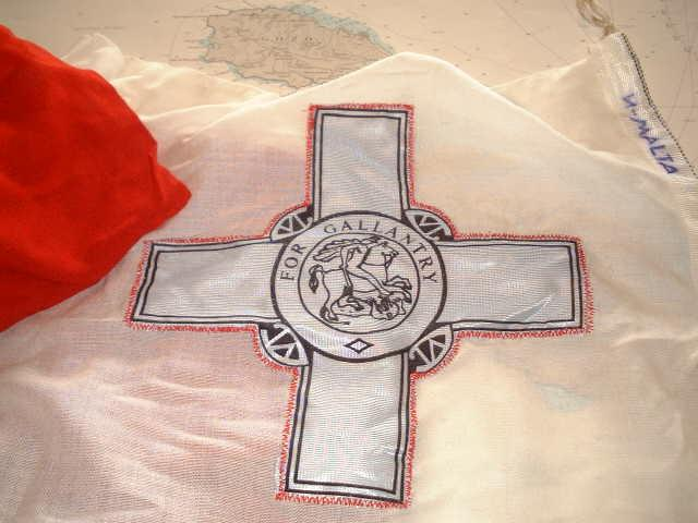 The George Cross is displayed on the flag of Malta