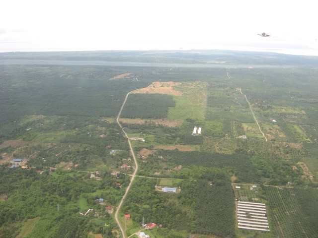 Typical view of area taken from plane flying into Sandakan. The confluence is probably somewhere near the top of the picture.