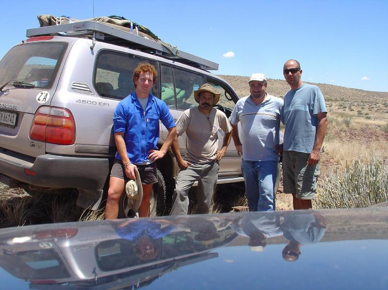The intrepid explorers: the friendly farmer's son on whose ground the confluence is located, Bryan van der Merwe, myself (LJ du Toit), and my brother Hennie