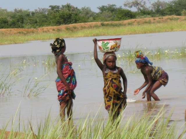 Fulani girls at a water reservoir