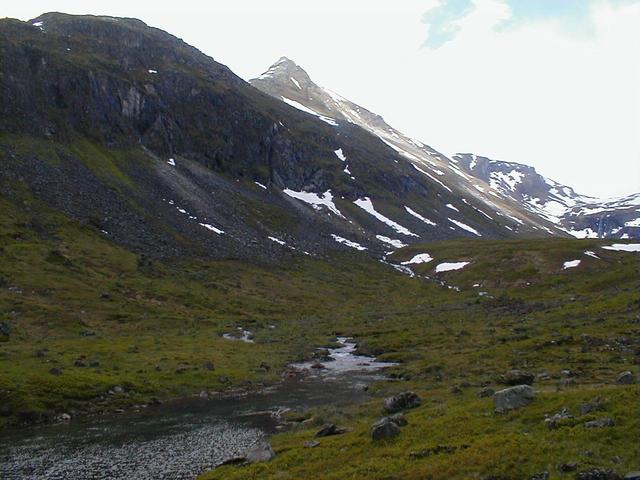 View south to the confluence. The confluence is on the slope in the left of the picture, about where the strip of sun is.