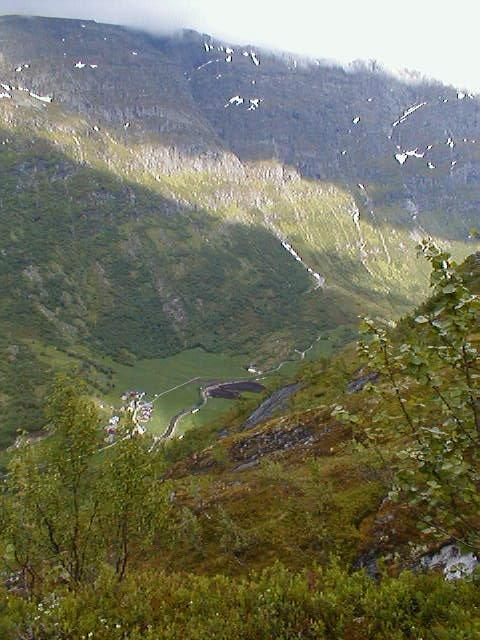 View from the north end of the valley of the confluence, down to the valley below, the farm Vollset, the start of Flovegen over to Strynevannet