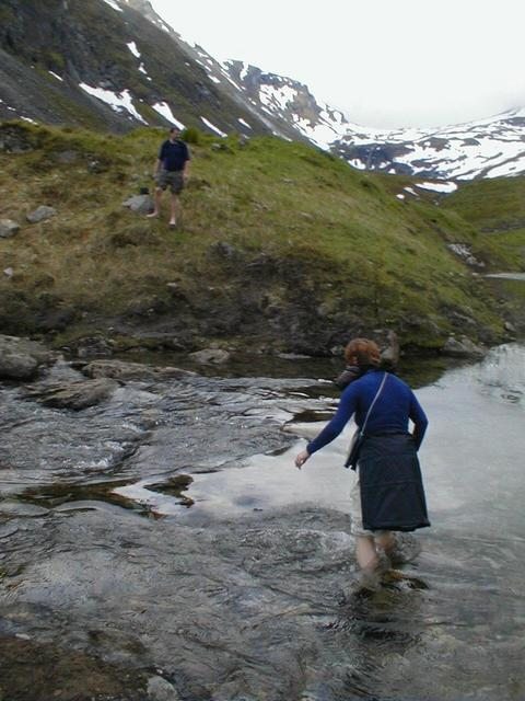 Gjertrud vading the small river in the valley of the confluence. Cold.
