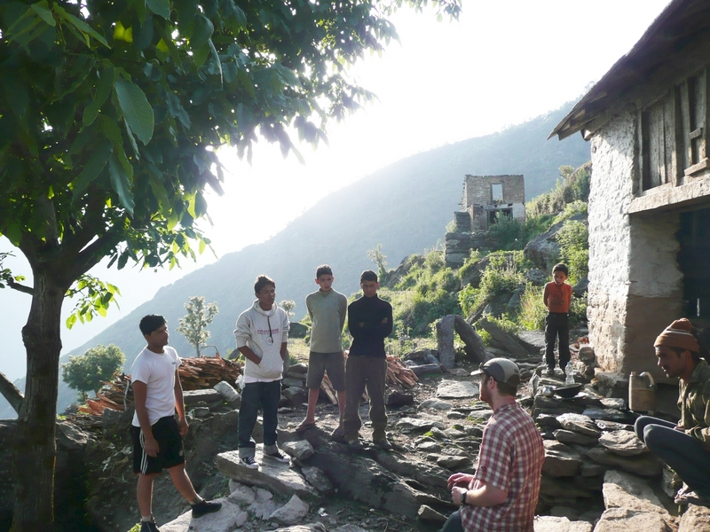 The village of Naji, the closest we got to the confluence.  Manesh in white sweatshirt across on left, Mitch in plaid on right