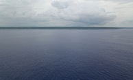 #6: A drone's eye view of Niue from 18.9839°S 169.9375°W, at ~50 m above the ocean. The confluence point is about 7 km farther away than this, but a shipboard view from the point might be similar.
