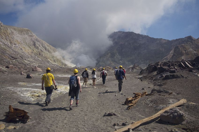 Touring volcanic White Island (with mandatory helmets and gas masks) nearby