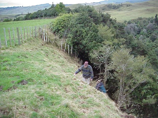 Murray Ellis and Anne Olsen climbing the gully on the way out of the confluence meadow.