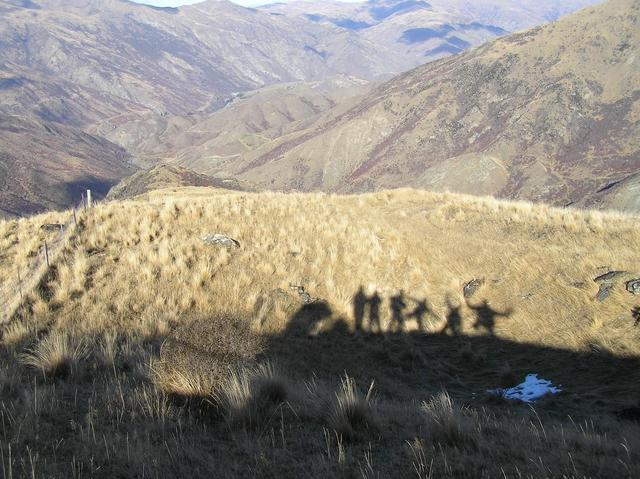 Our shadows, looking to the southwest, showing the Gentle Annie Valley in the distance that we hiked up.