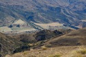 #7: A telephoto view down to Highway 6 and the small farming settlement of Gibbston