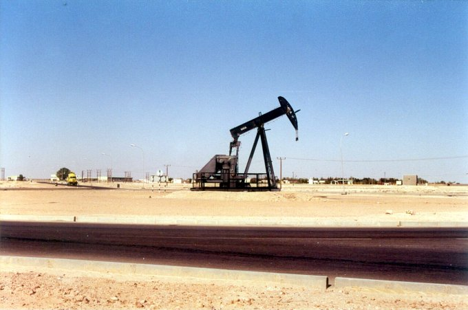 "The new tarmac, ""Nodding donkey"" roundabout, and Bahja oil camp"