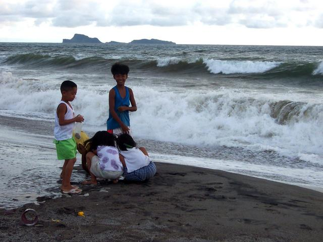 Children playing with the big waves