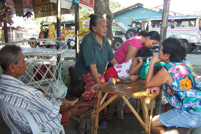The Mariano Family, Lolo Recto, Lola Judith, daughter-in-law Minella & children at the roadside sari-sari store: they accomodated us while in the beachside.