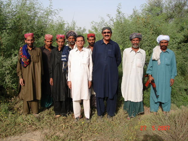 Mr Bijarani and Mr Kasim with guards and locals at confluence point