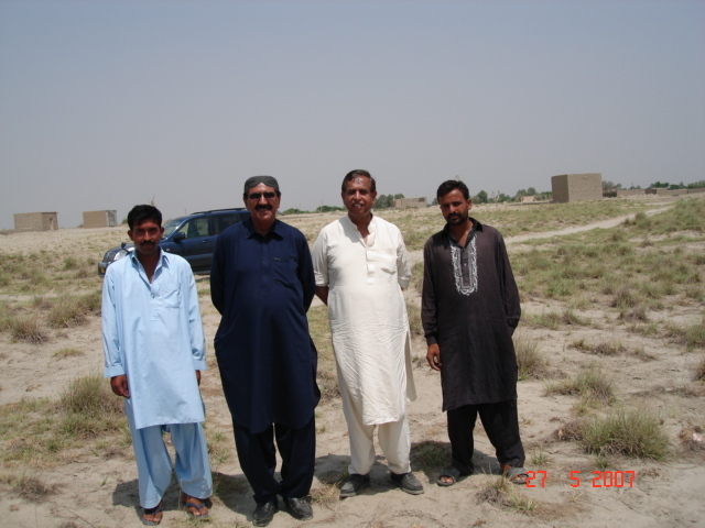 Mr Kasim and myself with locals at confluence point