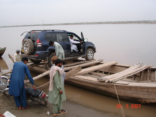 Ayoob driver in jeep after loading it on Boat