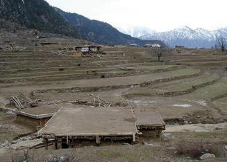 #1: The village of Shera Kot.  The jumbles of lumber are structures destroyed in the earthquake.