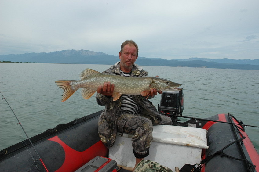 Boatman Peter Logunov, assisting to visit the CP, with a successful trophy