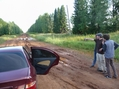 #5: Greg strategizing with Jesse and Evgeny how to cross the giant mud puddle.  Evegeny's Nissan on the left.